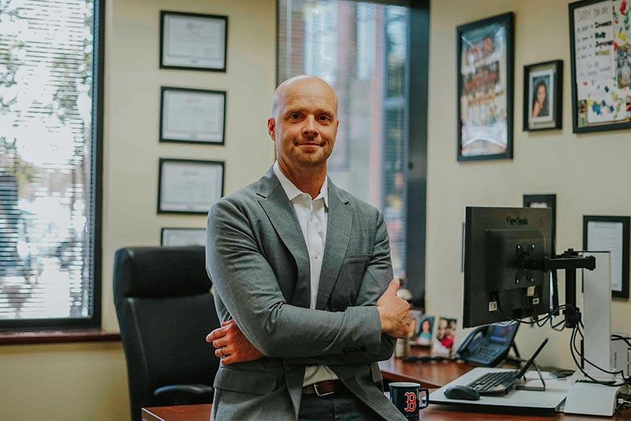 Charlie Wood standing in his office